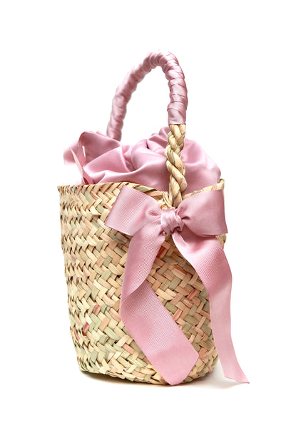 Side view of Straw bucket bag with pink ribbon