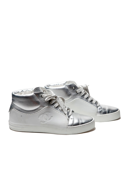 The right view of Chanel white and silver coloured sneakers