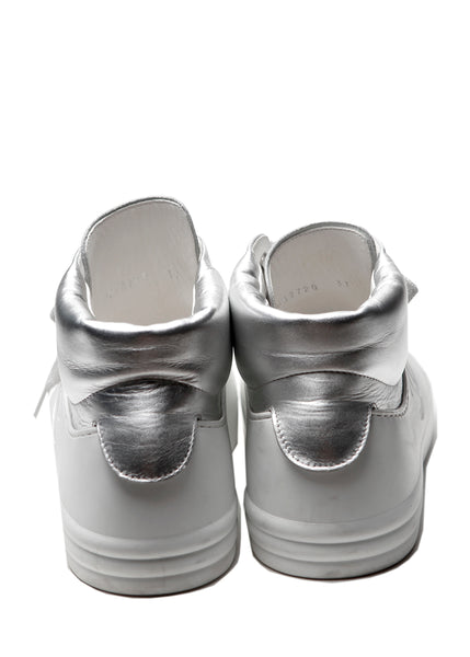 The back view of Chanel white and silver coloured sneakers