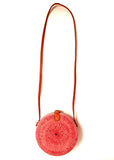 The front view of pink red rattan bag from Bali