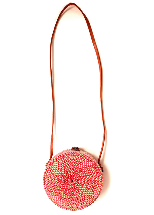 The back view of pink red rattan bag from Bali