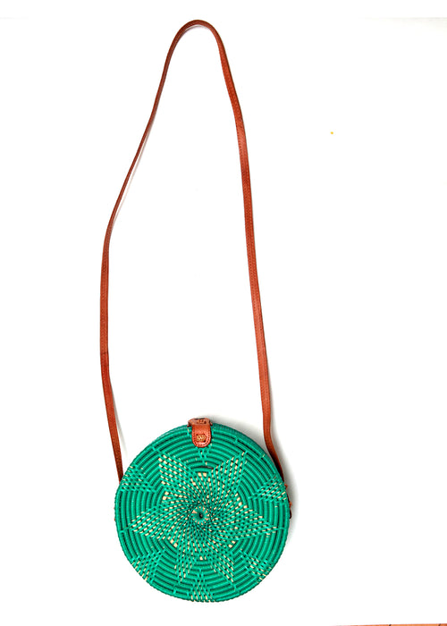 Front view of green rattan bag from Bali