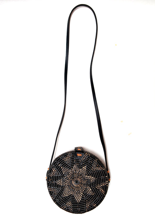 Front view of black rattan bag from Bali