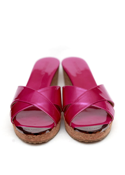 The front view of Jimmy Choo pink patent leather clogs