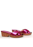The right view of Jimmy Choo pink patent leather clogs
