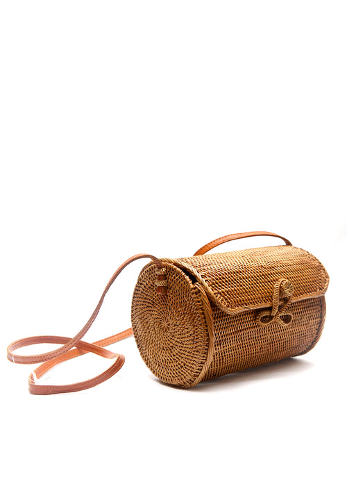 The profile view of Rattan cylinder shape bag