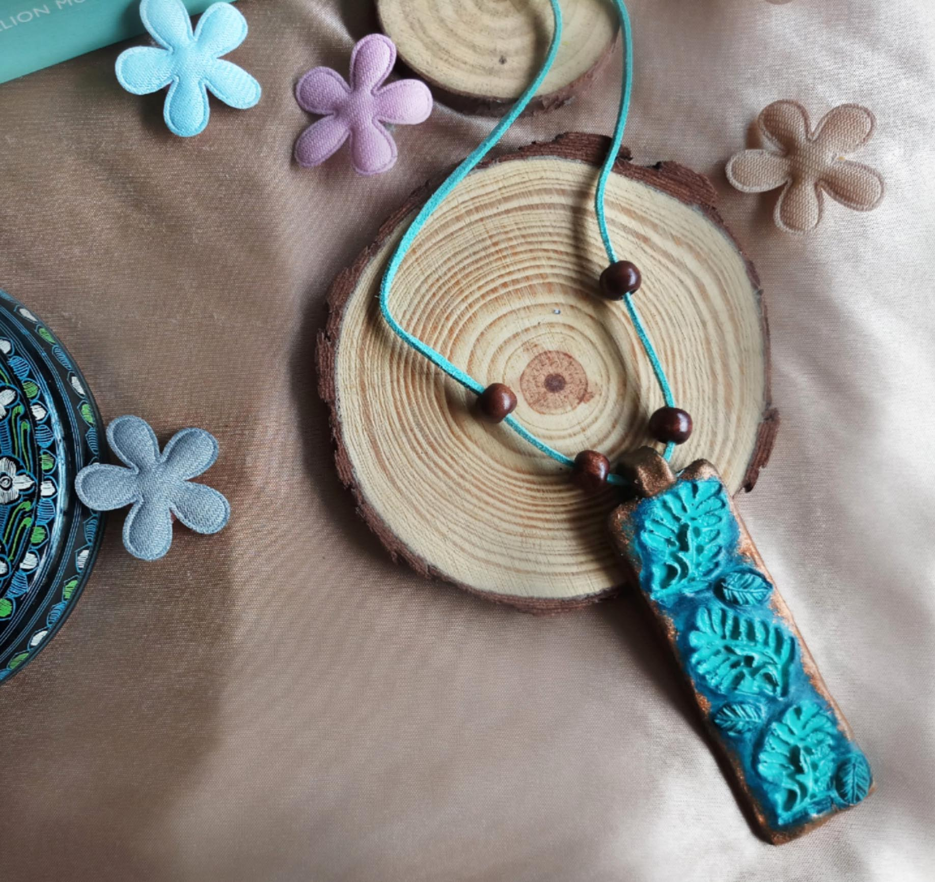 Blue leaves clay pendant