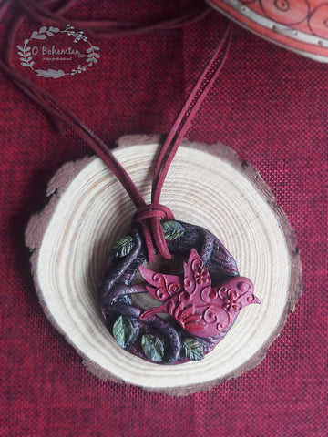 Birdie in bush clay pendant