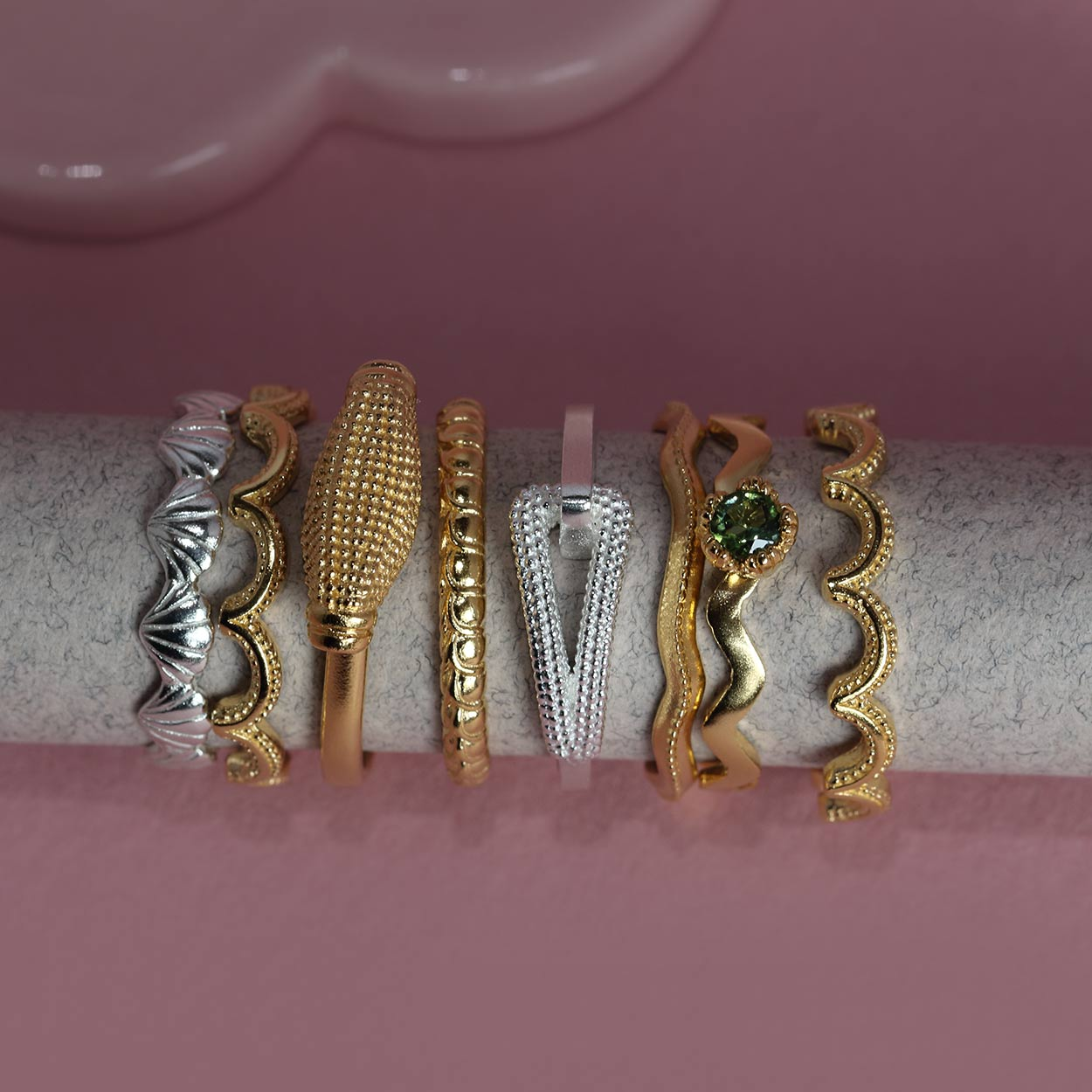A selection of gold and silver milgrain rings