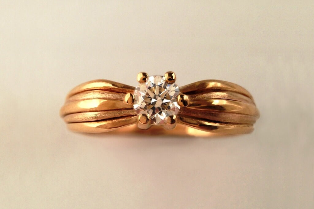 Rose gold and diamond engagement ring