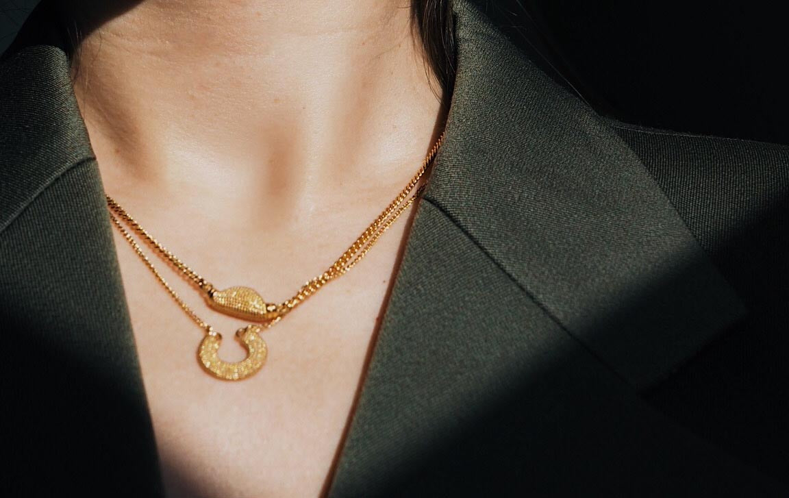 Textured gold necklace stack, lucky horseshoe gold nugget jewellery