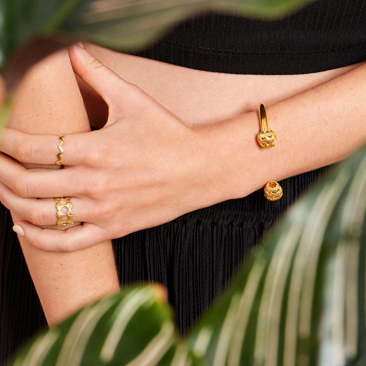 Gold plated bangle on model