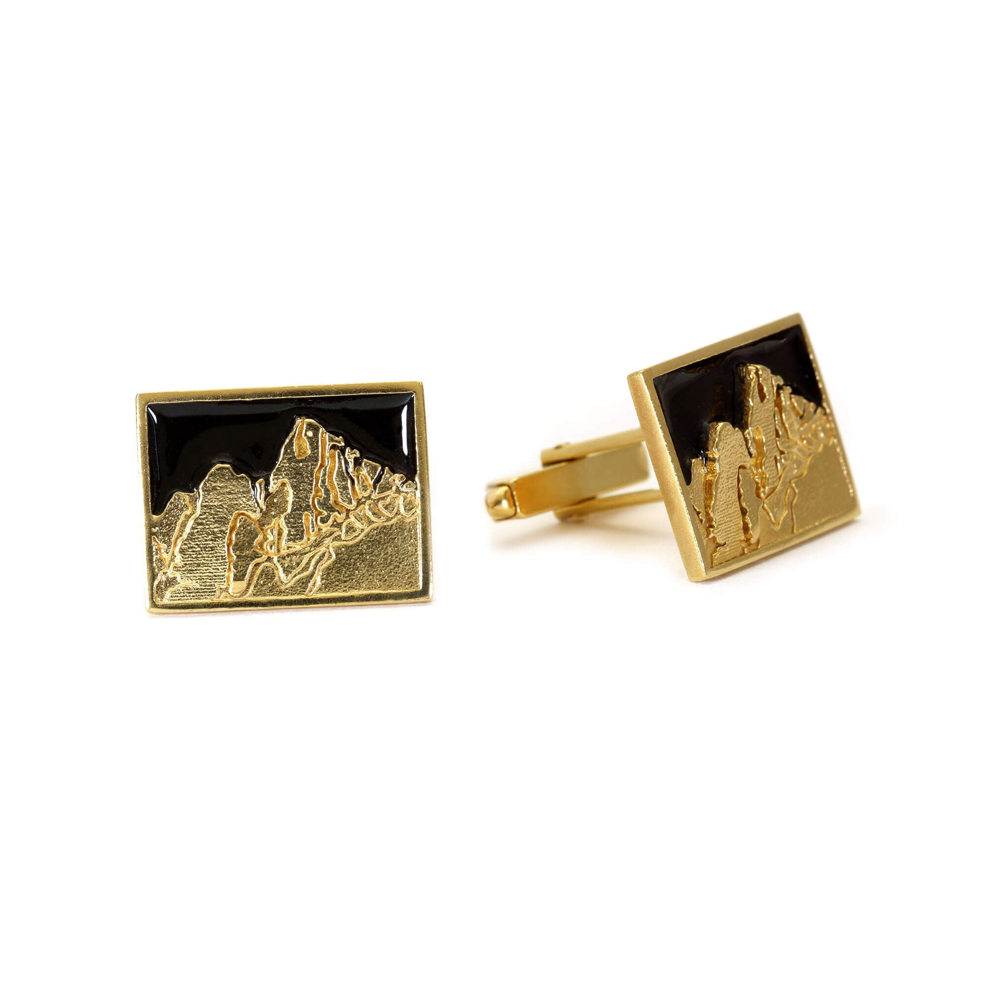 A pair of Cuillin Ridge cufflink in gold and black enamel