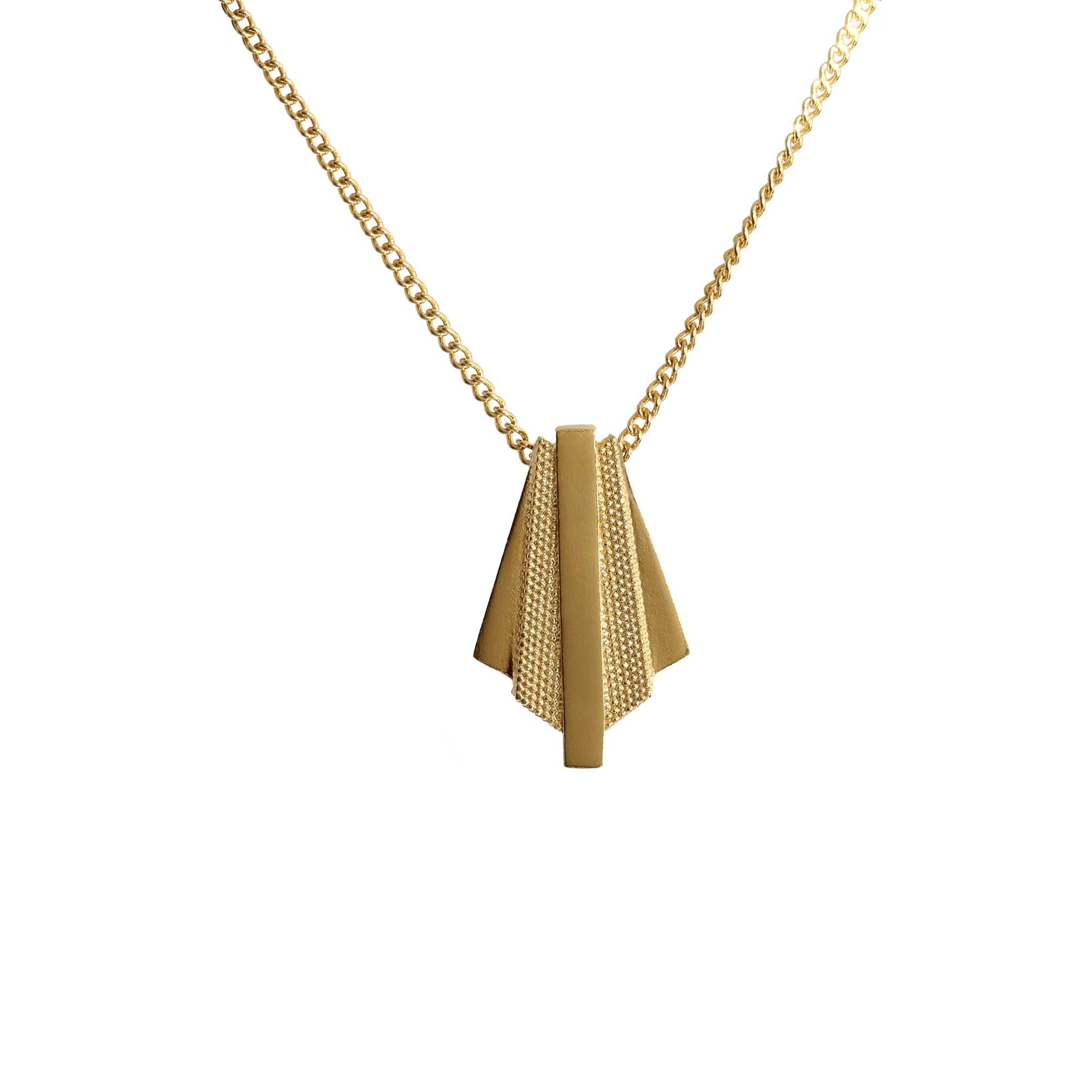 Contrasting textures on the Ruptus Slab Yellow Gold Pendant