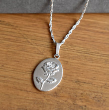 Sterling silver oval pendant embossed with a Rose as June birth flower