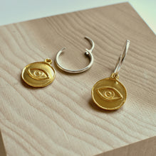 Silver Hoop Earrings with gold plated evil eye charm