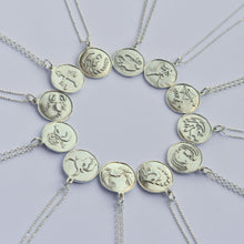 Horoscope Necklaces handmade in sterling silver adorned with the signs of the zodiac