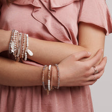 Symbolic stacking bracelets designed for you to layer and stack to tell your story.