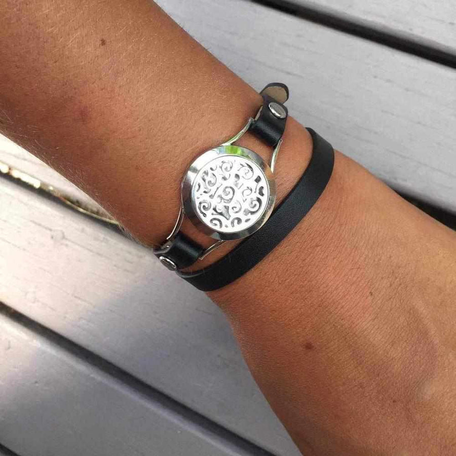 Black Leather Wrist Wrap on an Arm with Grey Slatted Background
