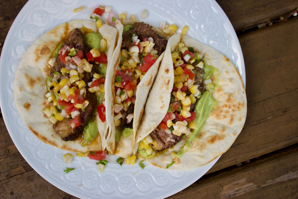 Brisket Tacos with Corn Salsa & Avocado Crema