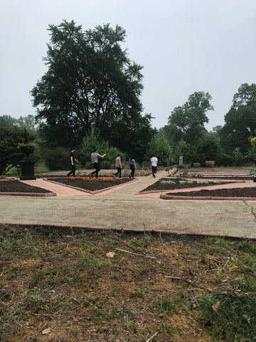 The producers putting the finishing touches on the garden before it was revealed to the chefs.