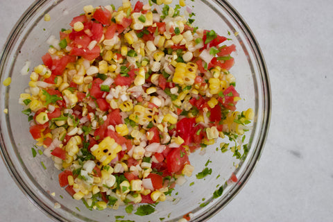 Preparing the corn salsa.