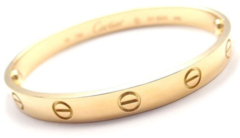 558986fa9b4 You obviously can t go wrong with the classic yellow gold that Meghan has  sported. Ours comes with certificate and box. Find the yellow gold Love  bracelet ...