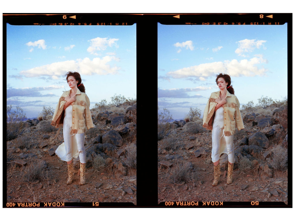woman wearing vintage western style clothing in desert at sunset wearing erin cuff jewelry