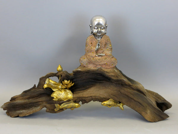 Ceramic Silver Baby Buddha Ornament Figurine in Peach and Gold Sat on Drift Wood Base with Gold Fish, Lily Pads and Lotus Flower