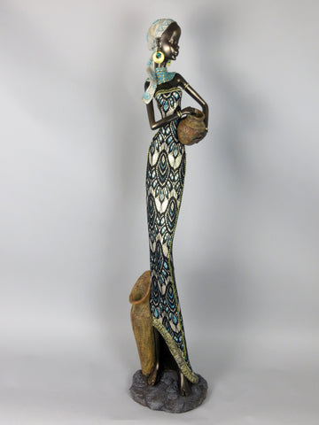 African Lady Figurine Ornament Figurine in Gold, Black and Blue Dress Holding Pot to Side