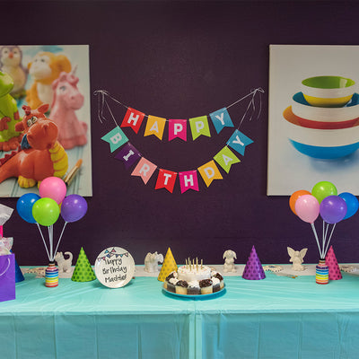 Beautiful table display for birthday party at paint your own pottery studio in Wisconsin Dells