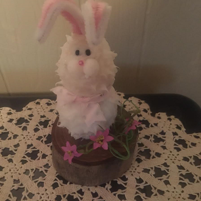 White Thumper Bunny Battery Operated Candle On A Log