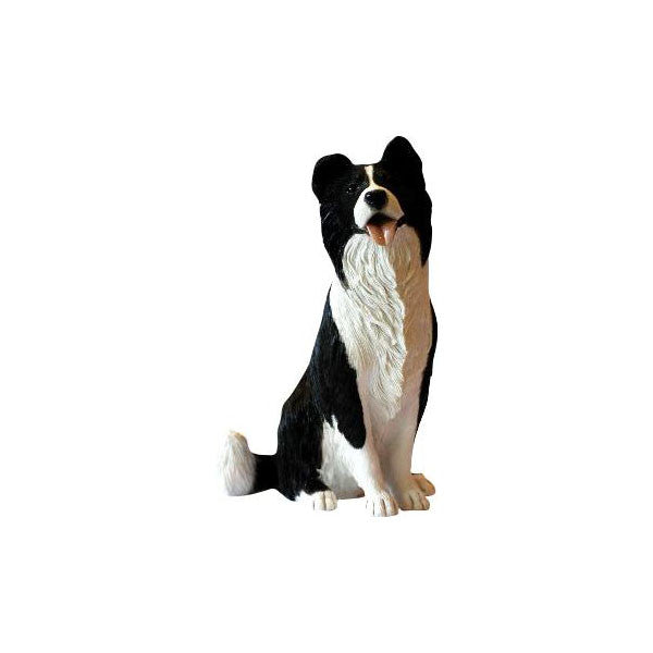 Black and white Border Collie sitting sculpture