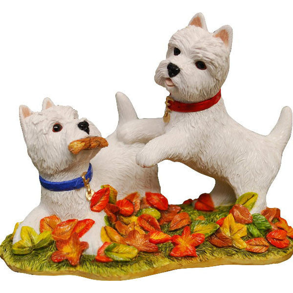 Autumn westies playing in Leaves
