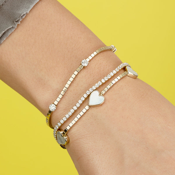 GOLD AND MOTHER OF PEARL HEART TENNIS BRACELET