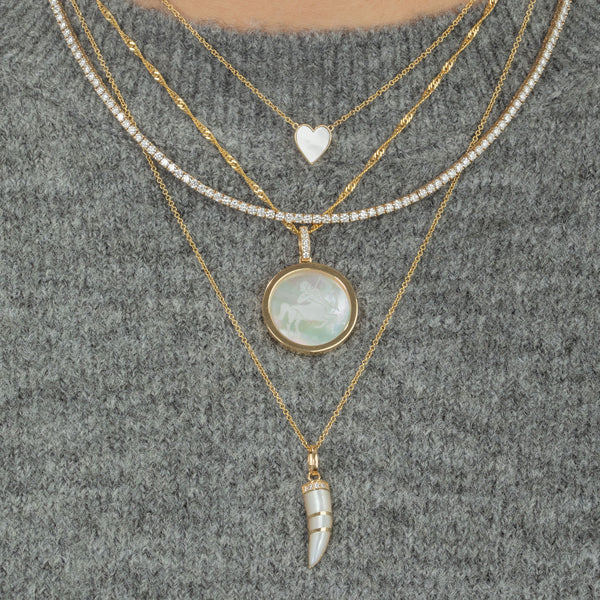 DIAMOND AND MOTHER OF PEARL ZODIAC PENDANT