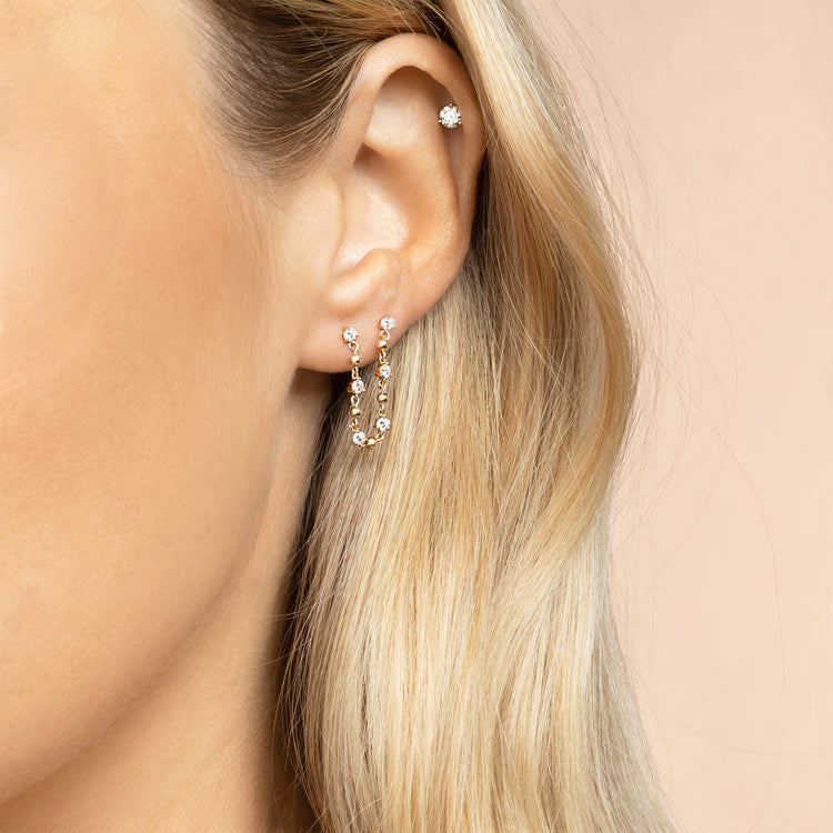 DIAMOND STUD AND SPHERE CONNECTED EARRING