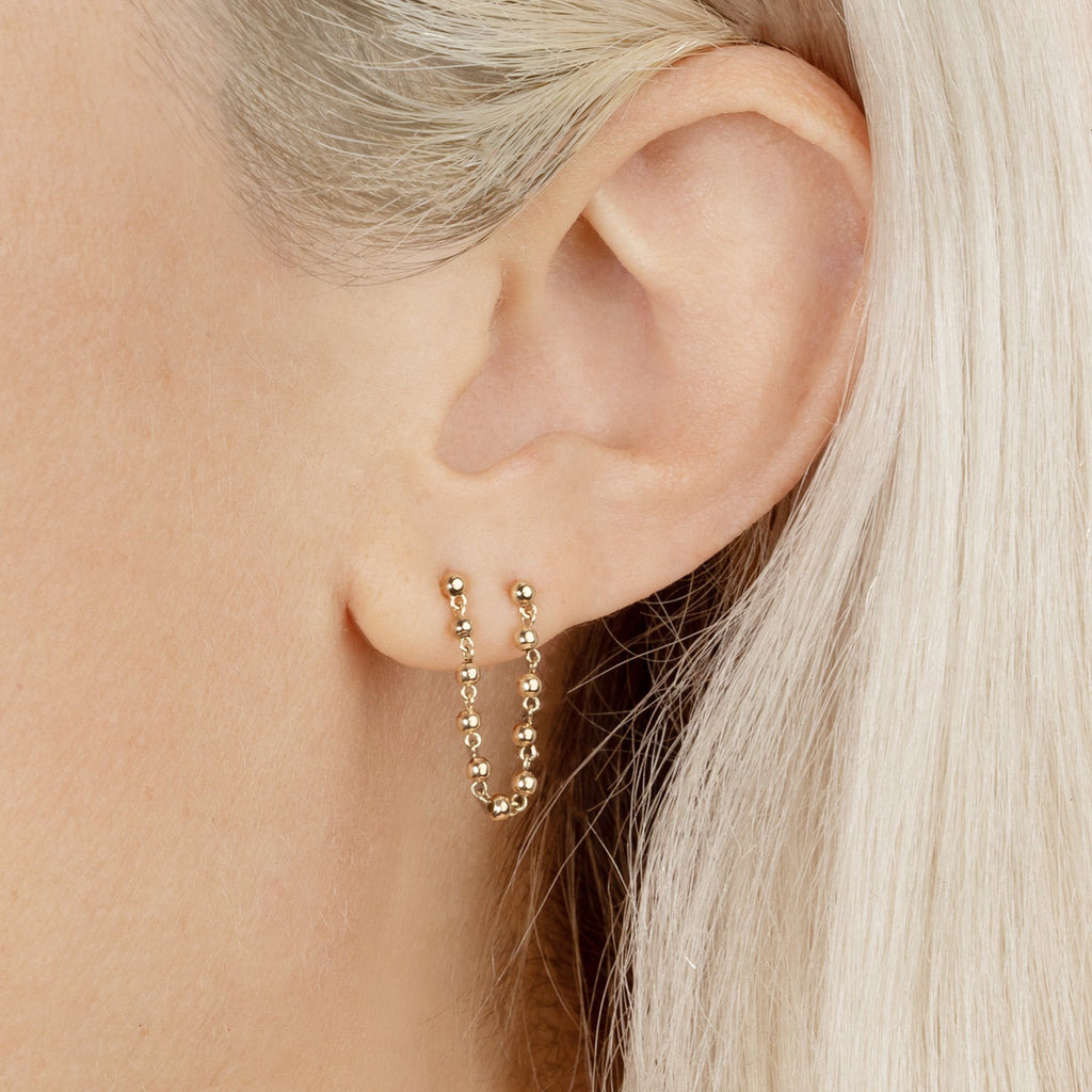 GOLD STUD AND SPHERE CONNECTED EARRING