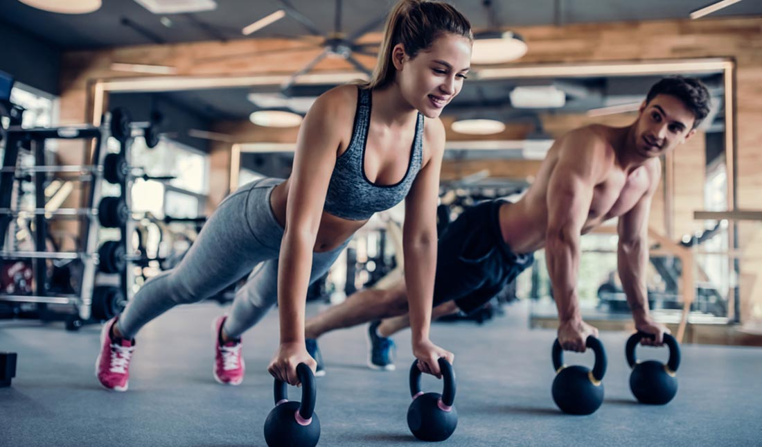 couple working out at gym