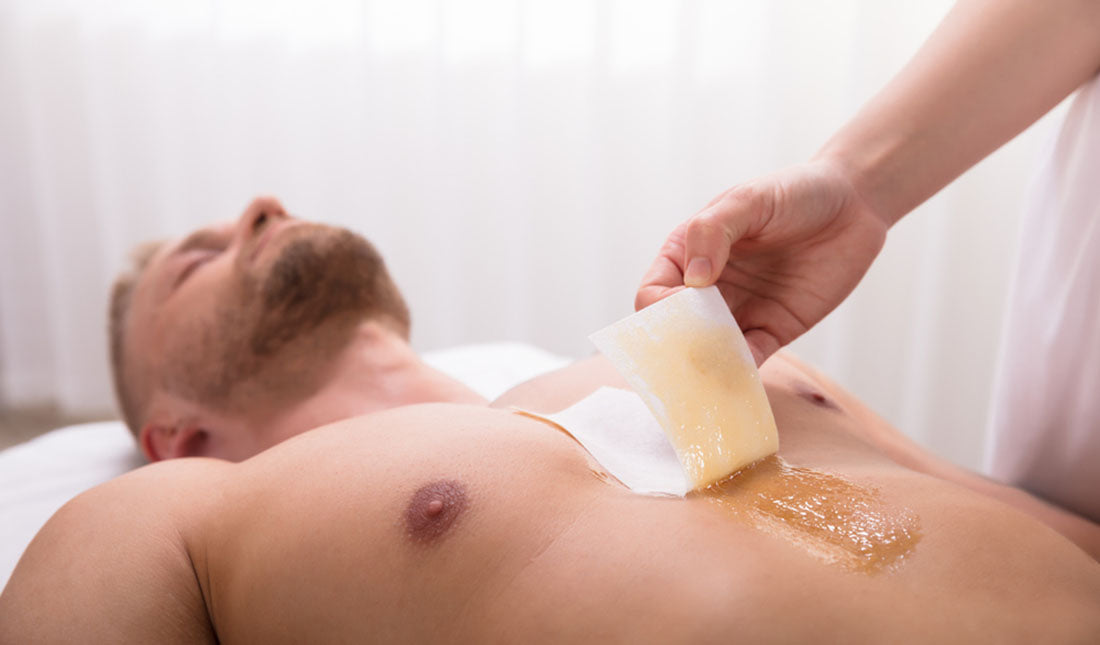 esthetician waxing mans chest