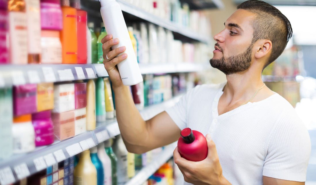 guy choosing shampoo