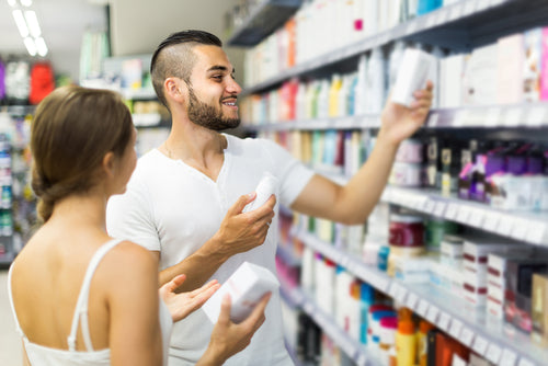 man buying cosmetic cream in store