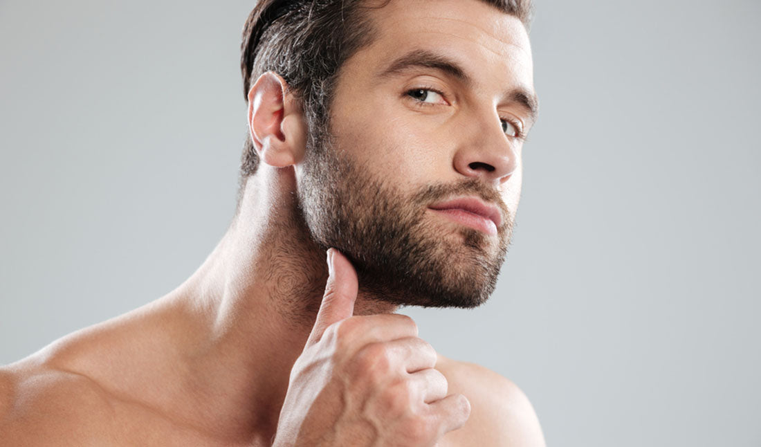 man rubbing beard