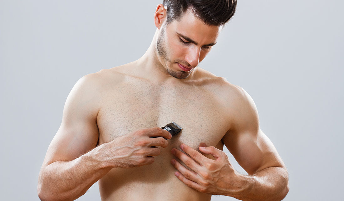 man shaving chest