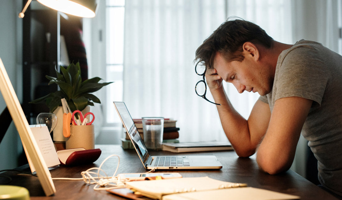 man stressed while working