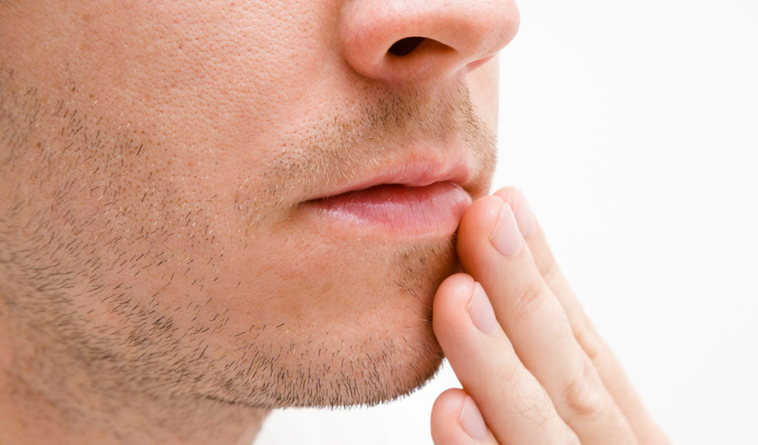 man touching lips closeup