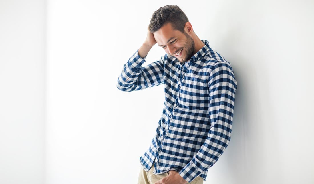 man wearing plaid shirt