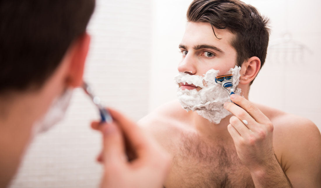 shaving face using mirror