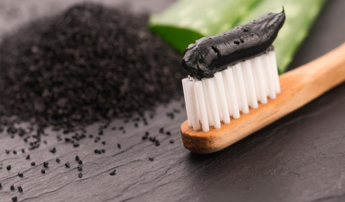 toothbrush with charcoal paste
