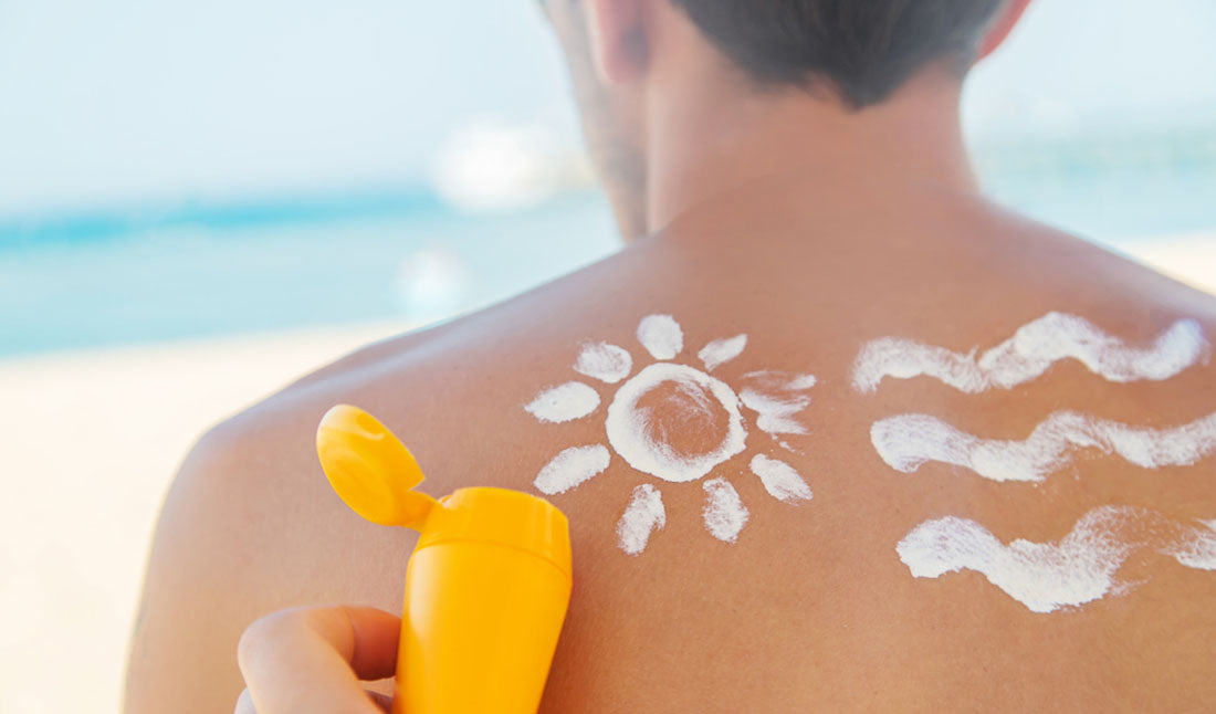 applying sunscreen to back